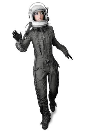 astronauta: astronauta de la moda mujer longitud completa traje espacial casco aislado en blanco