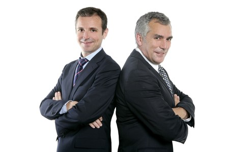business partner: two adult businessman posing back together team portrait