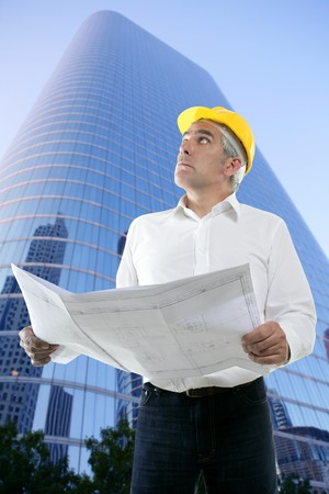 expertise architect senior engineer plan looking up city construction buildings photo