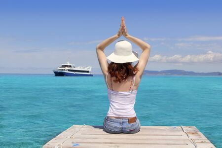 Yoga woman relax tropical sea Formentera Balearic hands up photo