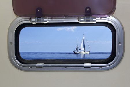 ship porthole: Boat porthole sailboat view blue ocean sea sky horizon