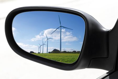 rearview car driving mirror view windmills electric aerogenerators photo