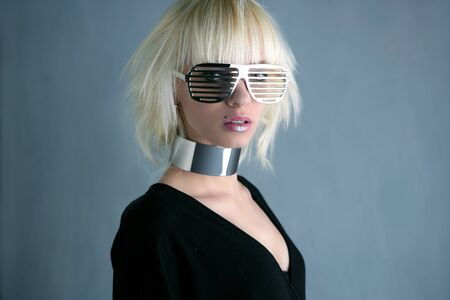 blonde fashion futuristic silver glasses girl  gray background Stock Photo - 7712722