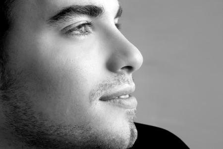 face close up: handsome profile smile portrait young man face detail closeup Stock Photo