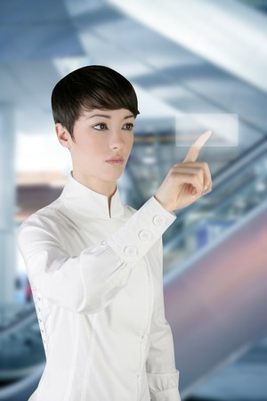 futuristic woman: futuristic businesswoman finger touch pad on modern office