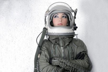 space suit: aircraft  astronaut spaceship helmet woman fashion portrait over silver