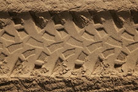 quad car tires footprint in beach summer sand  photo
