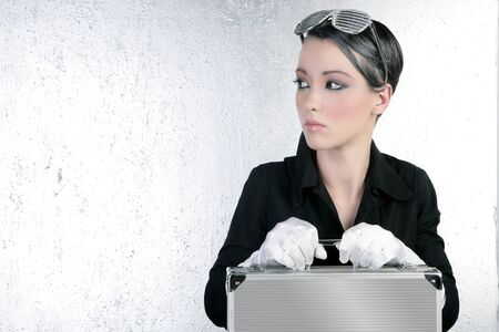 futuristic businesswoman holding silver briefcase fashion short hair brunette photo