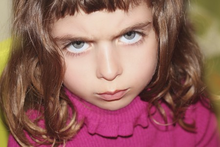 defy outface little girl portrait looking camera gesture blue eyes Stock Photo - 7780276