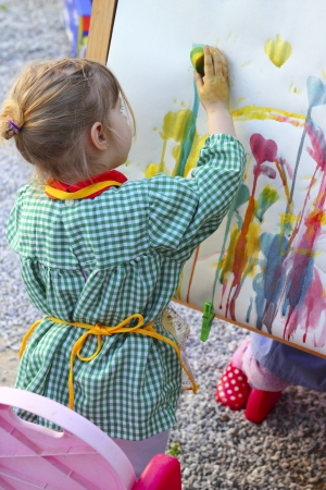 desing: artist little girl children learning artwork painting abstract colorful picture   Stock Photo