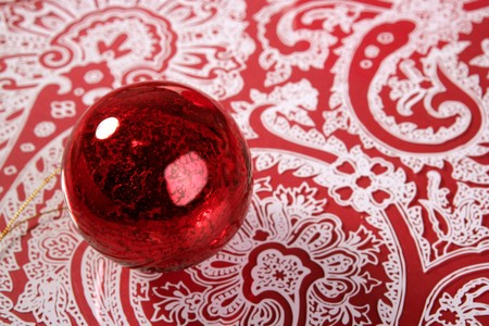 Chrsitmas red ball over indian pattern background photo
