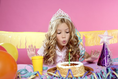 birthday celebration: little blond girl  in a birthday party  Stock Photo