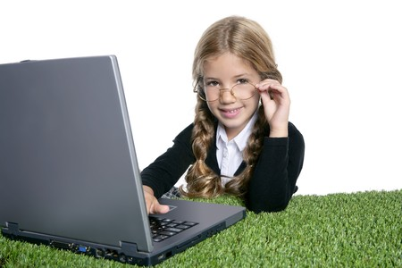 little blond school girl  with laptop photo