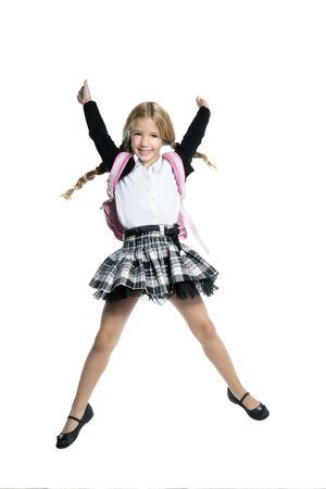 school uniform girl: little beautiful girl jumping Stock Photo
