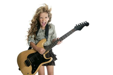 girl playing guitar: little blond girl  playing guitar Stock Photo