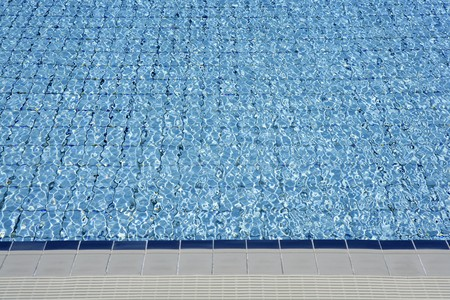 Blue tiles pool  water waves perspective summer background photo