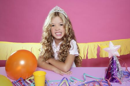 bored little blond girl in a birthday party with cake and candle on pink background Stock Photo - 7780969