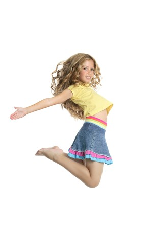 little beautiful girl fly jumping isolated on white studio background photo