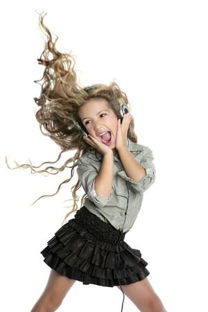 long skirt: dancing little blond girl headphones music singing on white background