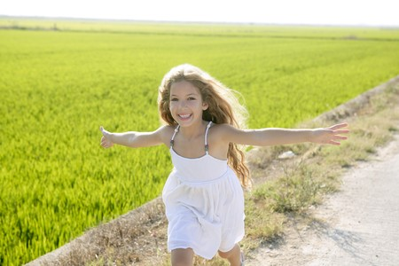 running open arms little happy girl green meadow field track Stock Photo - 7780950