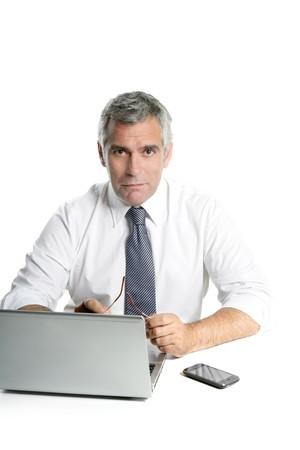 businessman senior gray hair working laptop computer white desk background Stock Photo - 7907578