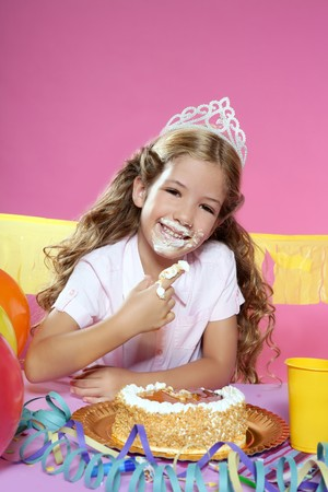dirty blond: little blond birthday party girleating cake with hands on pink background