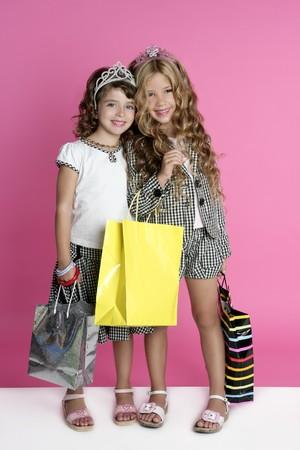 pretty little girl: Little shopper humor shopaholic two girls stand full length pink background