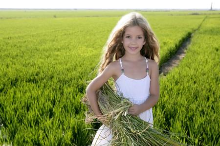 Little smiling girl farmer on rice fields green outdoor portrait Stock Photo - 7907629