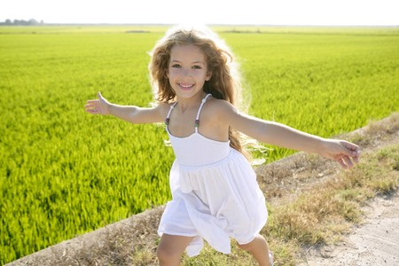 running open arms little happy girl green meadow field track Stock Photo - 7907624