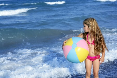 swimwear: Beach little girl colorful ball vacation playing in blue sea