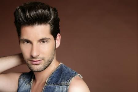 italian man: Handsome sexy young man portrait denim jacket brown background