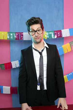 colourful tie: Holiday party young man funny glasses and suit