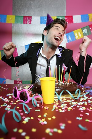 Happy gesture man in holiday party with chocolate cake Stock Photo - 7907606
