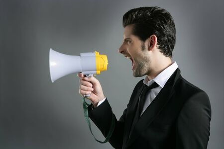 bullhorn businessman megaphone profile shouting loud Stock Photo - 7907584