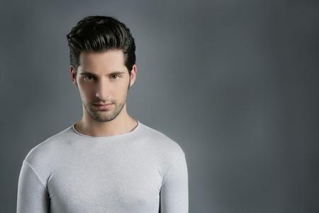 Fashion trendy young man silver futuristic  portrait over gray Stock Photo - 7907628
