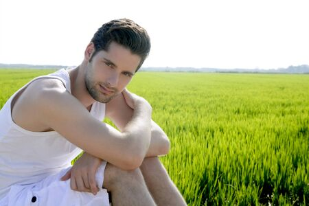 Young man outdoor happy relaxed on green rice field meadow Stock Photo - 7907601