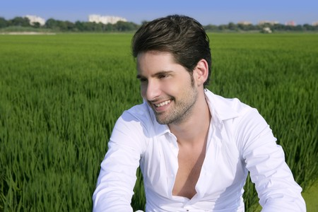 Young man outdoor happy relaxed on green rice field meadow Stock Photo - 7907620