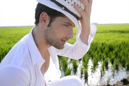 Mediterranean man portrait white hat in green meadow rice field Stock Photo - 7907598