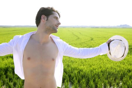 Summer man open shirt outdoor meadow with white hat in hand Stock Photo - 7907589
