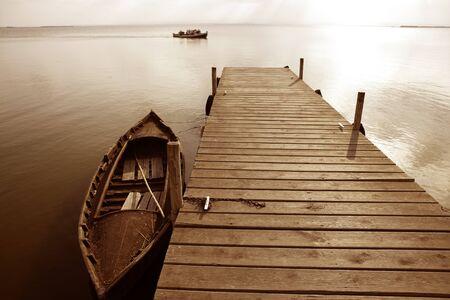 wetlands: Albufera lake wetlands pier with boat in Valencia Spain Stock Photo