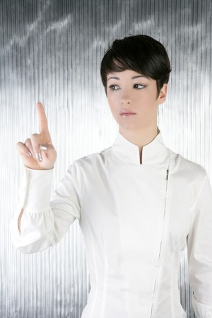 futuristic androgynous businesswoman touchpad finger touching pad photo