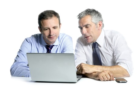 two people talking: expertise businessman team working laptop computer white desk Stock Photo