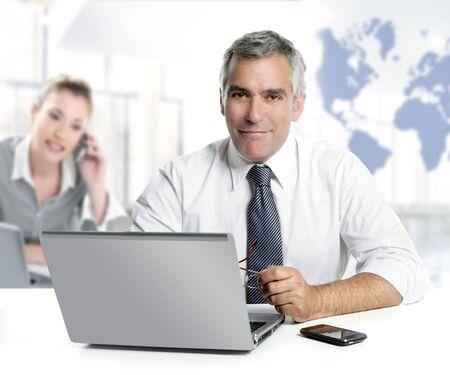 world of work: businessman senior expertise teamwork world map global communication