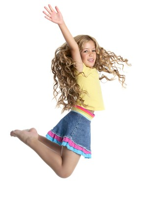 curly hair child: little beautiful girl fly jumping isolated on white studio background