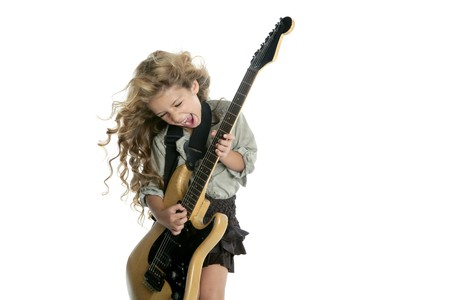 little blond girl playing electric guitar hardcore wind blowing hair photo