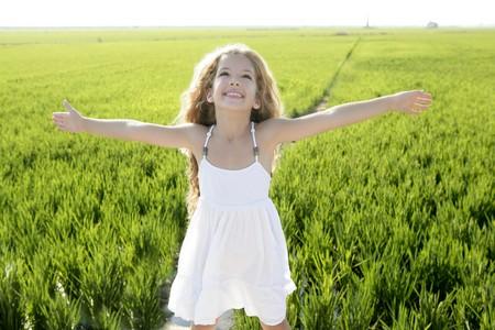 arms open: open arms little happy girl green meadow rice field