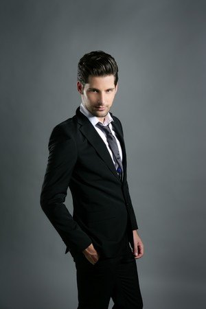 Fashion young businessman black suit casual tie on gray background Stock Photo - 7907638