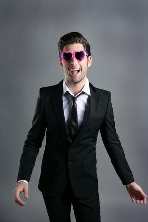 funny heart shape pink sunglasses modern fashion businessman photo