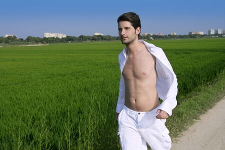 Young man outdoor running in a green rice field meadow Stock Photo - 7907662