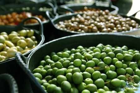 pickling: olives in pickling brine pattern background texture in market